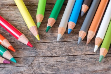 Creativity: Multi-colored pencils on rustic wooden table