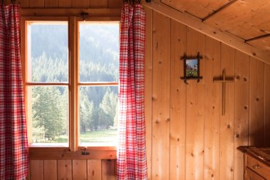 Holiday in the mountains: Rustic old wooden interior of a cabin