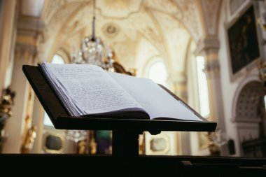 open Bible book in church
