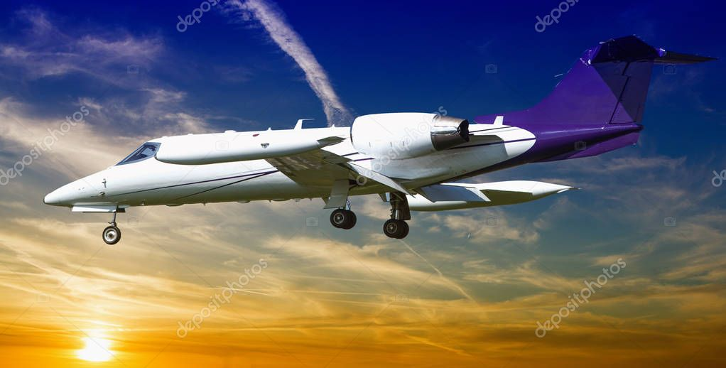 Private jet plane in a beautiful sky at sunset