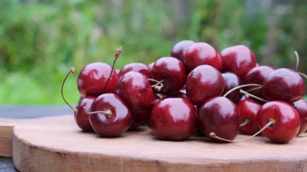 Ripe fresh sweet cherry wooden background.