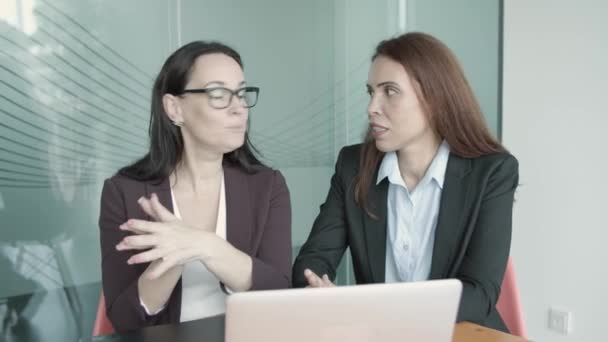 Content businesswomen discussing project, video conferencing