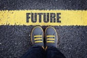Fotografie Future line child in sneakers standing next to a yellow line