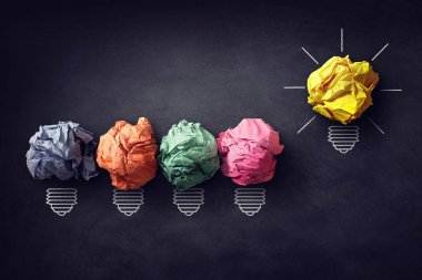 Good idea concept crumpled paper ball light bulbs on blackboard