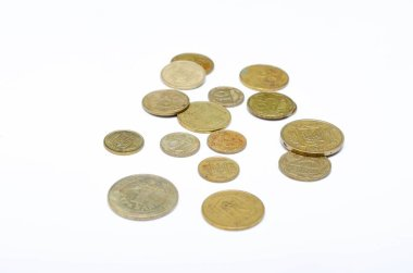 Ukrainian coins on a white background in close-up. Coins in a heap close-up, in the form of a falling pyramid, in a man's hand