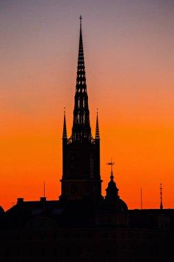 STOCKHOLM, SWEDEN - July 2019: Stockholm skyline at sunset, beautiful sunset over Stockholm Old town (Gamla  Stan), Spires against the sunset sky, Sweden