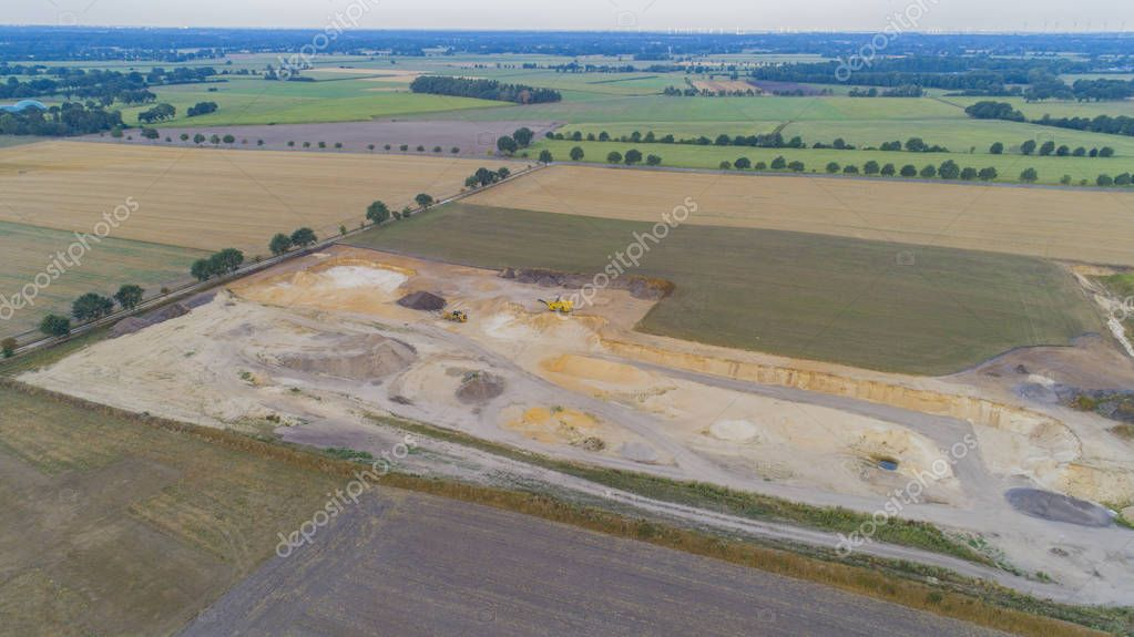 Aerial view Gravel quarrying from the air in a gravel pit