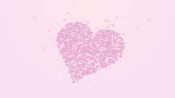 rosa Herz ist auf rosa Hintergrund isoliert. Die Ansammlung kleiner Herzen ergibt ein großes Herz. das ganze Herz wird vergrößert. Nahaufnahme. Kopierraum.
