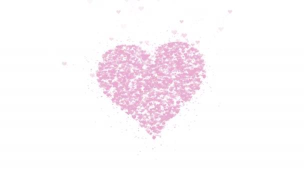 verschwommenes rosafarbenes Herz ist auf weißem Hintergrund isoliert. Die Ansammlung kleiner Herzen ergibt ein großes Herz. Nahaufnahme. Kopierraum.