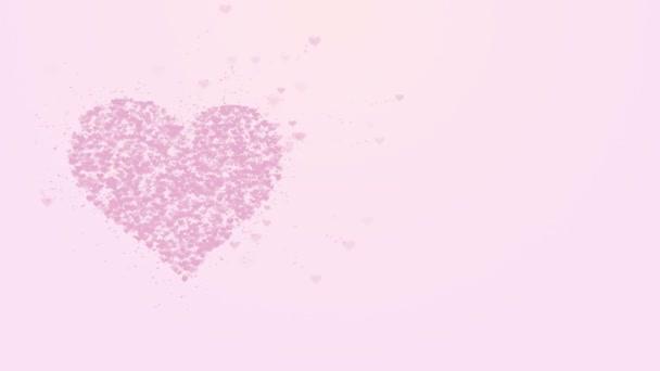 verschwommenes rosafarbenes Herz ist auf hellrosa Hintergrund isoliert. Die Ansammlung kleiner Herzen ergibt ein großes Herz. Linke Allokation. Nahaufnahme. Kopierraum.