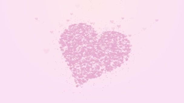 verschwommenes rosafarbenes Herz ist auf hellrosa Hintergrund isoliert. Die Ansammlung kleiner Herzen ergibt ein großes Herz. Nahaufnahme. Kopierraum.