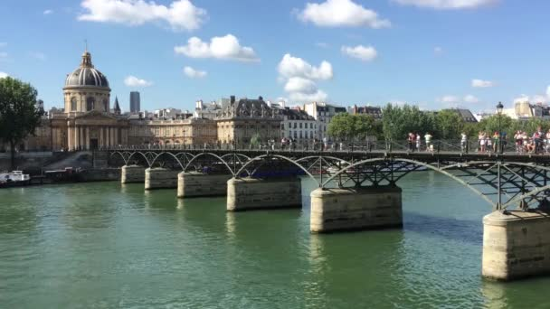 Bridge with people walking across it in Paris