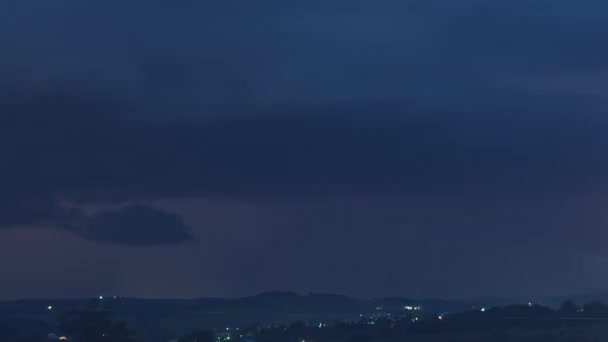 Timelapse of a dramatic thunderstorm with lightning discharges with rain over the hills and countryside
