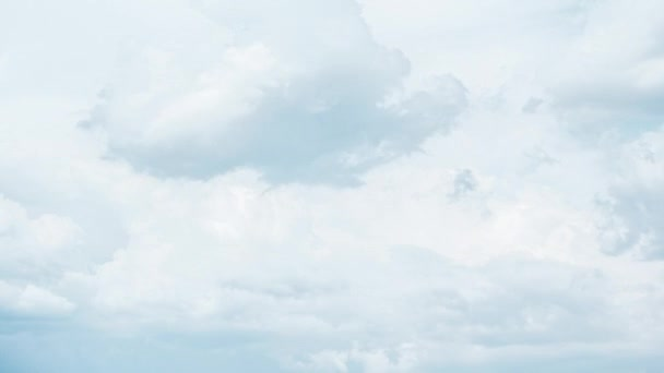 Timelapse of white fluffy clouds. Aerial view of light blue sky