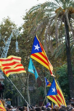 Barcelona, Catalonia, Spain, October 10, 2017: flags and people on rally support for independence of Catalunya or Catalonia in Passeig Lluis Companys.