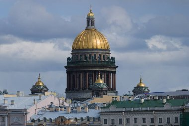 Golden dome of St. Isaac's Cathedral in St. Petersburg in Russia against the sky on a sunny day