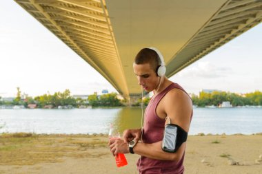 Athlete checking his smart watch