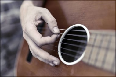 Close Up Of Guitarist Hand Playing Guitar. Musical And Instrument Concept. Outdoors And Leisure Theme.