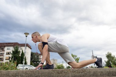 young male athlete exercising outdoor
