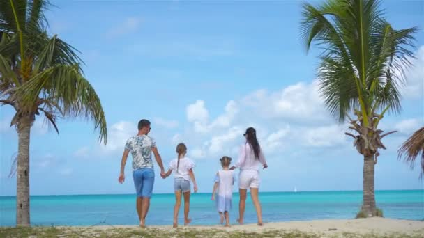 Family on the beach on caribbean vacation.