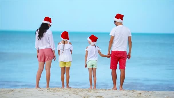 Happy family with two kids in Santa Hat on Xmas vacation