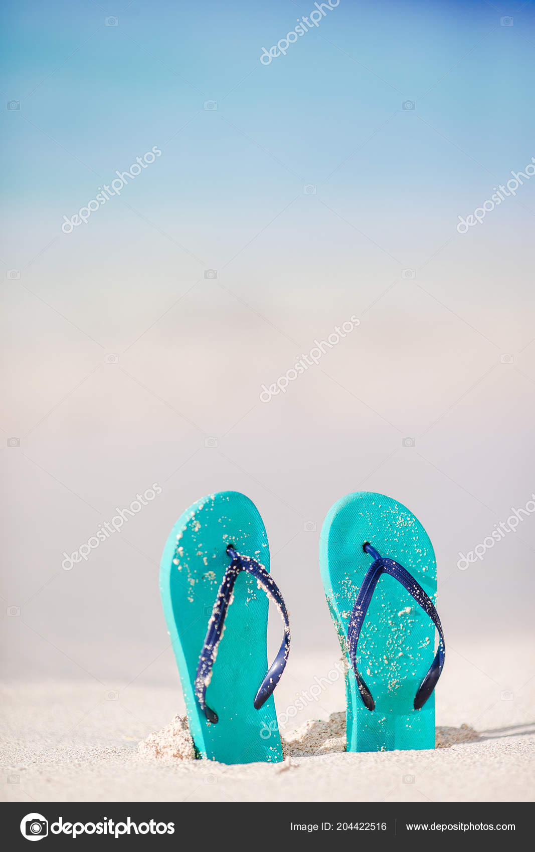 899aa8d62fb1a Summer holiday beach background with flip flops on a tropical beach.  Slippers on a sand with copyspace.