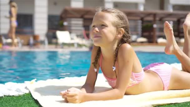 Beautiful Little Girl Having Fun Near An Outdoor Pool Stock