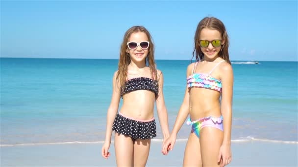 Kids having fun at tropical beach during summer vacation playing together.