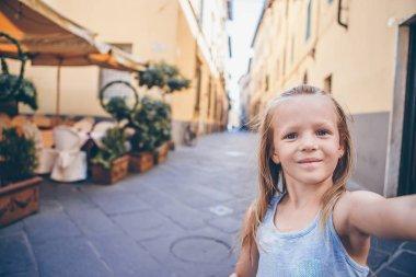 Adorable fashion little girl outdoors in European city