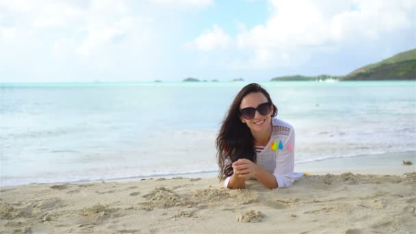 Woman on beach laughing and enjoying summer holidays l