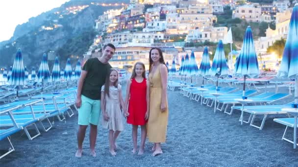 Family in front of Positano on the Amalfi coast in Italy in sunset