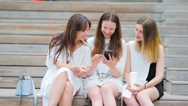 Lifestyle selfie portrait of young positive girls having fun and making selfie. Concept of friendship and fun with new trends and technology. Best friends saving the moment with modern smartphone