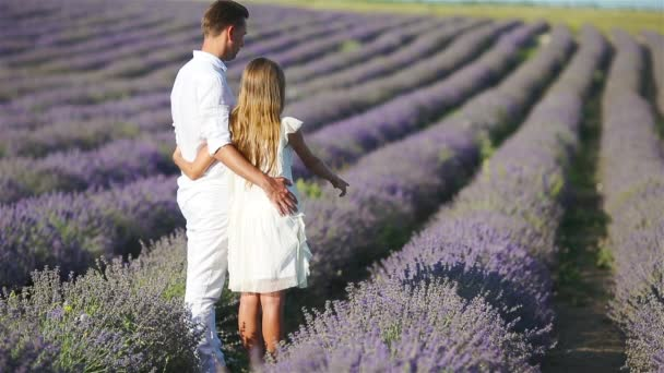 Family of two in lavender flowers field