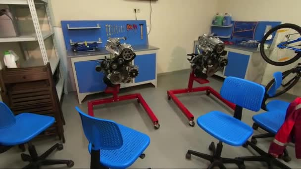 Auto repair shop in the children's development center. Playroom. The study of the car engine. Working tools.
