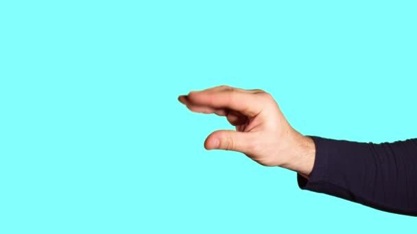Férfi kéz mutatja jele bla bla bla
