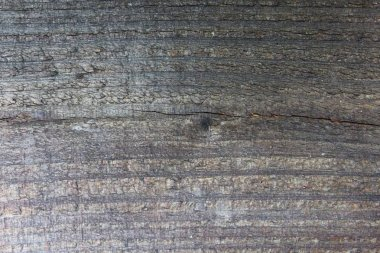 wooden background with an old brown board