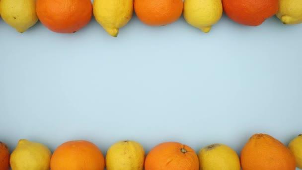 Oranges and lemons on blue background