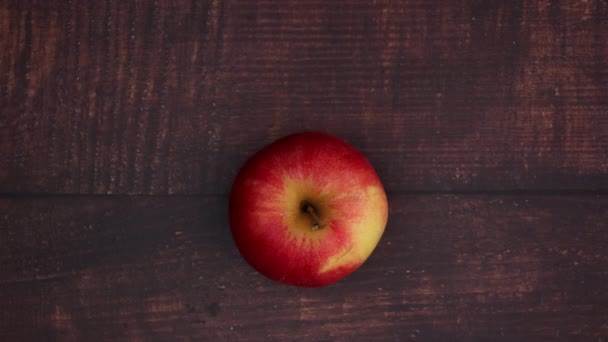 Red apple on wooden table - Stop motion