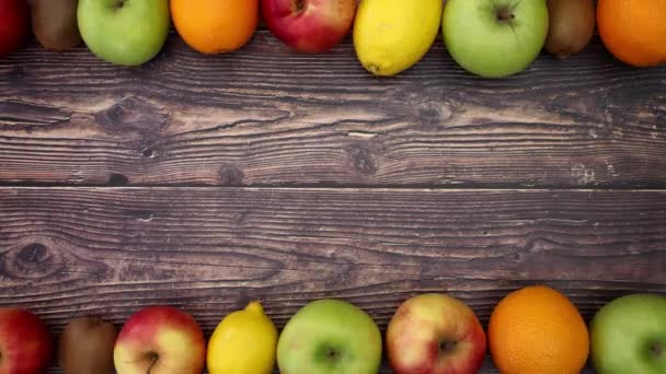 Fruits on wooden background - Stop Motion