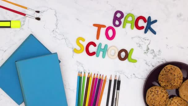 Back to school - Stop motion animation of school supplies appear and disappear from the table and back to school title