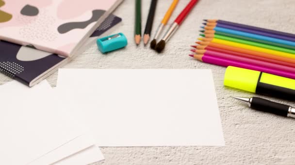 Writing back to school on paper and school supplies around - Stop motion animation