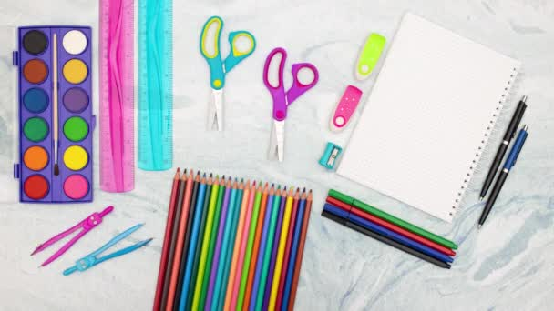 Stop motion animation of scissors and carpenters moving surrounded with school supplies