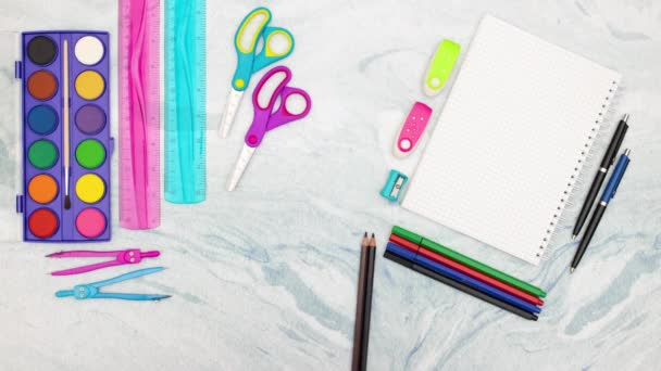 Colored pencils appear and disappear surrounded with school supplies - Stop motion animation