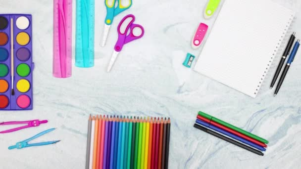 School supplies moving up and down on blue background - Stop motion animation