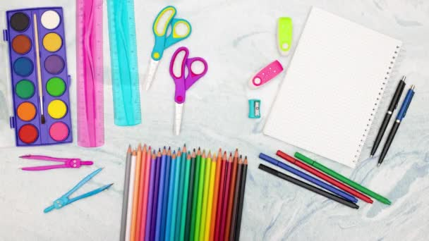 Stop motion animation of school supplies moving on the desk