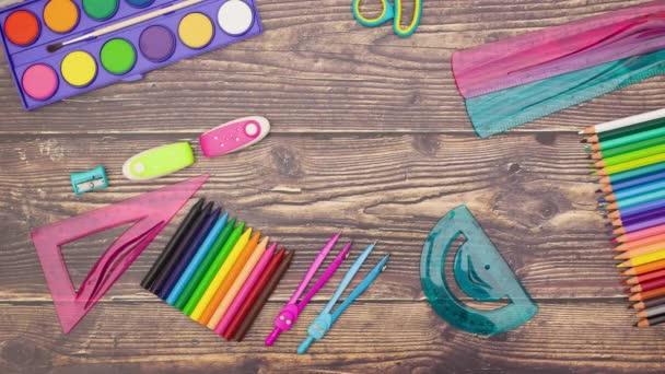 Stop motion animation of school supplies on the desk