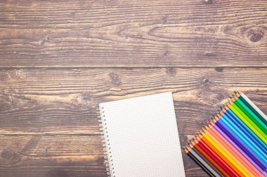 School concept - Different school supplies on the wooden table