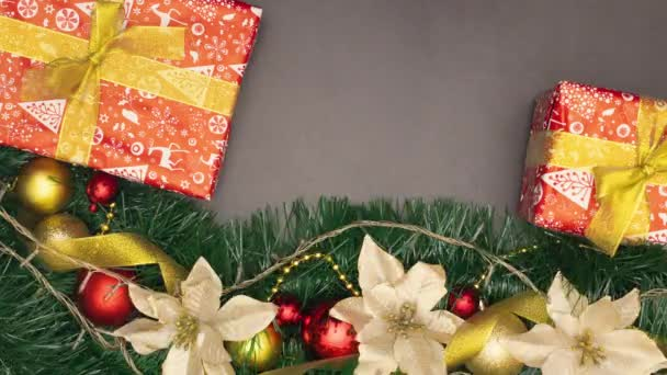 Looping Christmas decoration with Christmas presents and gold and red ornaments and lights blinking