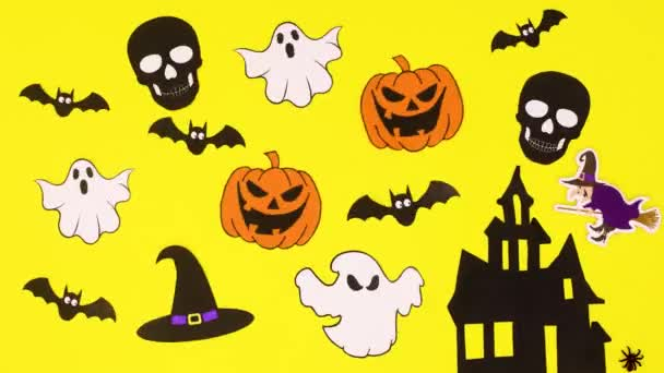 Halloween creepy decoration with halloween stickers on yellow theme. Stop motion