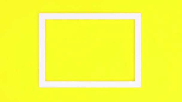 Creative photo frames on yellow theme. Stop motion